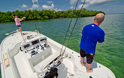 Two persons fishing the Marquesas Keys from a bay boat.